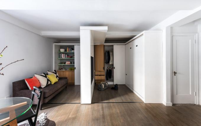 A sliding wall, which actually makes a two-room studio apartment.