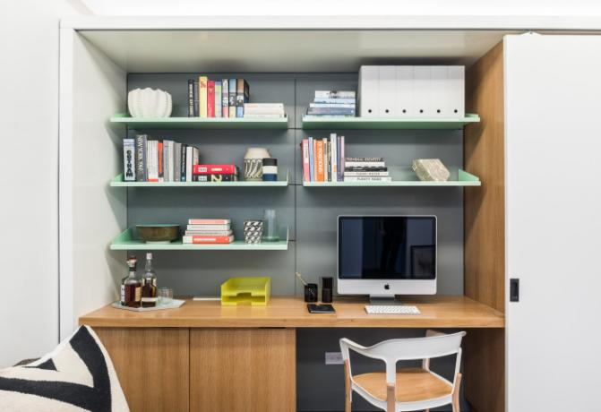 Desk in the living room, which can be hidden behind sliding doors.